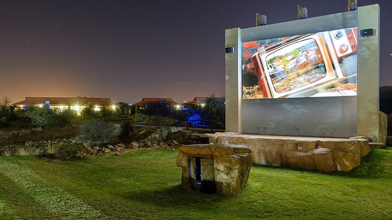 A large outdoor movie wall